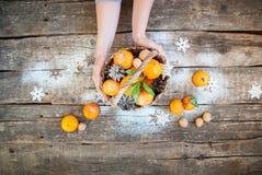 Christmas Composition Women Hand Tangerines Stock Photos