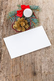 Christmas composition on wood with empty card Stock Image