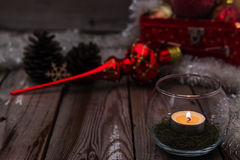 Christmas composition on wooden background. Beautiful christmas composition with candle on wooden background Stock Images