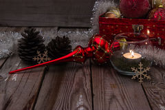 Christmas composition on wooden background. Beautiful christmas composition with candle on wooden background Royalty Free Stock Photo