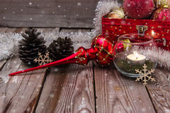 Christmas composition on wooden background. Beautiful christmas composition with candle on wooden background Royalty Free Stock Images