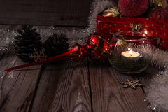 Christmas composition on wooden background. Beautiful christmas composition with candle on wooden background Stock Photography