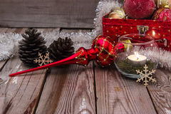 Christmas composition on wooden background. Beautiful christmas composition with candle on wooden background Stock Photo