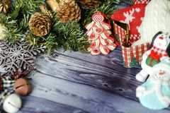 Christmas composition on wooden background red balls, gifts, and green Christmas tree branch with cones,burning candle. Foto Royalty Free Stock Photo