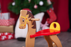 Christmas composition. Wooden rocking horse Royalty Free Stock Image