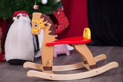 Christmas composition with wooden rocking horse Royalty Free Stock Image