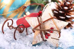 Christmas composition with wooden star and sleigh Royalty Free Stock Photo