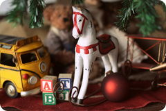 Christmas composition with wooden toy rocking horse. Royalty Free Stock Photos