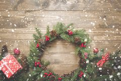 Christmas composition of wreath, gifts and vintage decor on wooden board. Flat lay. Top view. Copy space. Banner. royalty free stock photography