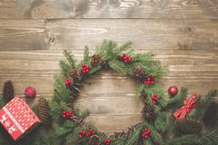 Christmas composition of wreath, gifts and vintage decor on wooden board. Flat lay. Top view. Copy space. Banner. royalty free stock image