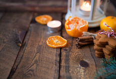 Christmas composition. Xmas cookies, tangerines, cinnamon, festi. Ve decoration, fir branches on dark old wooden background. Copy space Stock Image
