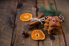 Christmas composition. Xmas cookies, tangerines, cinnamon, festi. Ve decoration, fir branches on dark old wooden background. Copy space Royalty Free Stock Photos