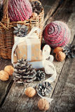 Christmas Compositiond with box, basket, pine cone Stock Images