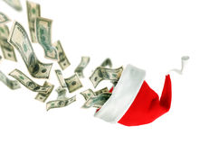 Christmas Concept. Christmas Hat & Flying US Dollars.Beautiful Concept Image royalty free stock photography
