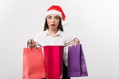 Christmas Concept - beautiful caucasian business woman shocking with gift inside shopping bag. royalty free stock photo