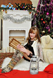 Christmas concept.Beautiful girl by the fireplace Royalty Free Stock Image