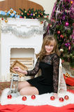 Christmas concept.Beautiful girl by the fireplace Royalty Free Stock Photography