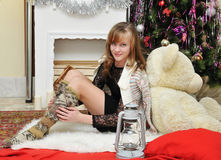 Christmas concept.Beautiful girl by the fireplace Stock Photo