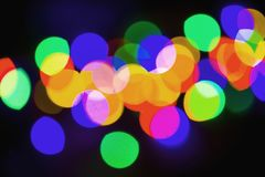 Background blurred bokeh. Lights Ceremonies. Christmas concept on a black background, fuzzy lights royalty free stock image