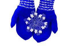 Christmas concept blue mittens with toy snowflake on a white background Stock Photography
