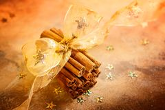 Christmas concept with cinnamon sticks Royalty Free Stock Images