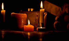 Christmas concept with candles. Gifts and teddy-bear isolated on black Stock Photo