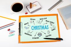 Christmas Concept. Chart with keywords and icons. Office desk with stationery.  Stock Image