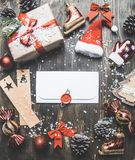 Christmas concept, Christmas decorations. gifts snow on a gray background, with an envelope in the middle stock photos