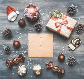 Christmas concept, Christmas decorations. gifts snow on a gray background, with an envelope in the middle royalty free stock image