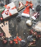 Christmas concept, Christmas decorations. gifts and snow on a gray background, space for text royalty free stock photos