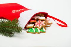 Christmas concept. Christmas sock with gingerbread and christmas Royalty Free Stock Images