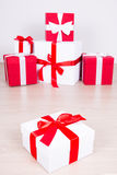 Christmas concept - close up of red and white gift boxes Stock Images