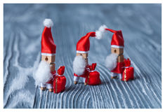 Christmas concept - clothespin. Three of Santa Claus. Retro Santa Claus with a few bags of gifts. Father frost. Papa Noel. (soft f Stock Image