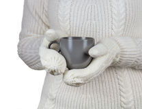 Christmas concept. Coffee cup in female hands dressed in mittens Stock Images