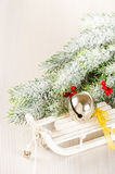 Christmas concept composition with sledge on light wooden backgr Stock Photos
