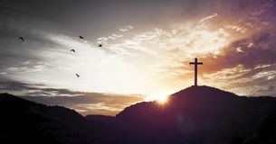 Christmas concept: Crucifixion Of Jesus Christ Cross At Sunset stock photos