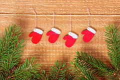 Christmas concept of decorated red painted mittens and twigs pin Stock Photography