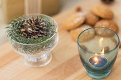 Christmas decoration and candle in glass holder stock images