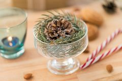 Christmas fir decoration with cone in dessert bowl stock photo