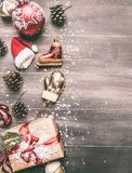 Christmas concept, Christmas decorations. gifts snow on a gray background, space for text stock photography