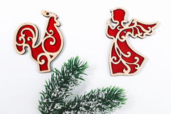 Christmas concept Fir tree branch, red wooden toys angel and coc Stock Images