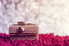 Christmas concept. Gift box bamboo on bokeh background Royalty Free Stock Image