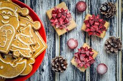 Christmas concept with gingerbread, gifts and snow. Stock Photos