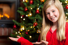 Christmas concept girl presenting copyspace Royalty Free Stock Photos