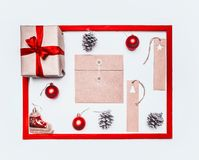 Christmas concept, greeting card, gift box, Christmas toys and cones, on white background, frame flat lay royalty free stock photography