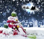 Christmas concept of happy snowman in winter Stock Images