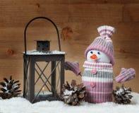 Christmas concept lantern and snowman Stock Photo