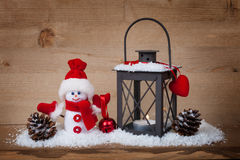Christmas concept lantern and snowman Royalty Free Stock Photography