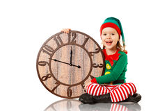Christmas concept. Little Elf with clock isolated on white royalty free stock photos