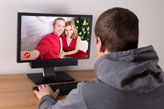 Christmas concept - man videochatting with his friends Royalty Free Stock Photo